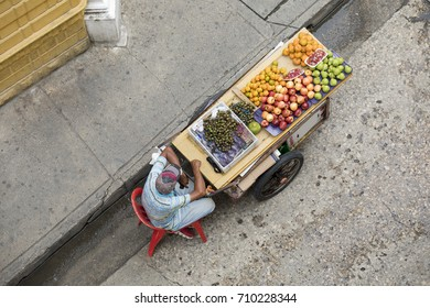 Vendor with the fruit cart in the center of Cartagena, Colombia