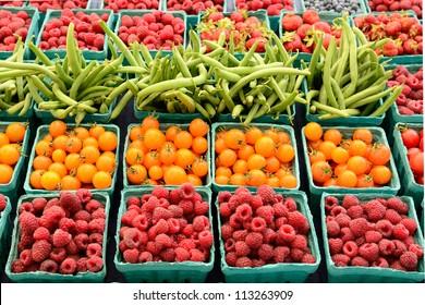 A vendor sales fresh organic berries at a local farmers market in Oregon