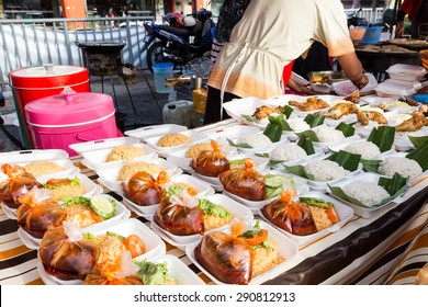 Vendor selling cuisine at street bazaar in Malaysia catered for iftar during Muslim fasting month of Ramadan