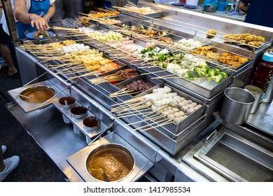 Vendor selling popular local delicacy named lok lok at street stall Penang