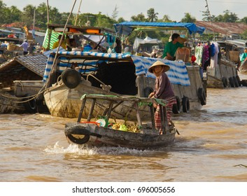 Vendor sells potatoes from a boat on a river in the Can Tho Floating Market in South Vietnam on Oct 17, 2011