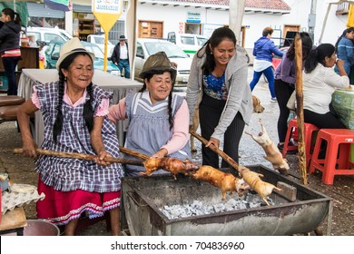 Vendors prepare cuy (guinea pig) for lunch in Gualaceo, Ecuador on Mar 13, 2016
