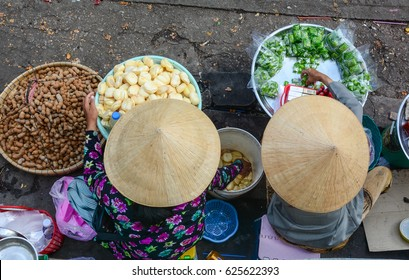 Vendors sell snacks on street in Saigon (Ho Chi Minh city), Vietnam. Saigon is the largest city in Vietnam and the former capital of the Republic of Vietnam.