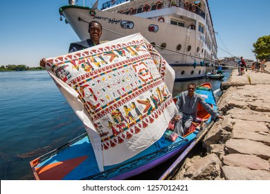 Vendors souvenir gifts for tourist boat tourists, Esna, southern Egypt, August 2015