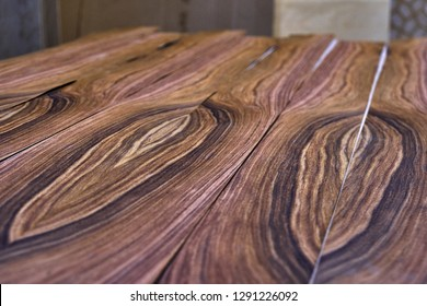 Veneer Santos Rosewood. Wood texture. Woodworking and carpentry production. Close-up. Furniture manufacture