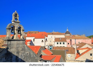 Venetian architecture of a church tower with three bells in the old town of Dubrovnik, Croatia