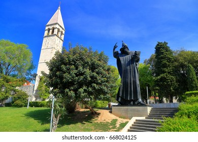 Venetian belfry and the large statue of Gregory of Nin in Split, Croatia
