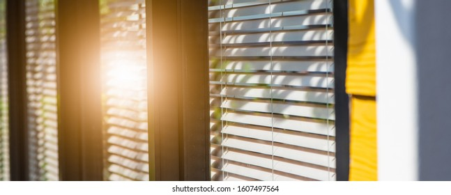 Venetian blind window mask, room interior with sunflare, blinds window decoration concept for banner or background.