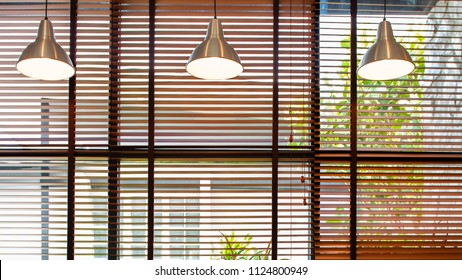 Venetian blind window, room interior with ceiling lamp beam, blinds window decoration concept for banner or background.