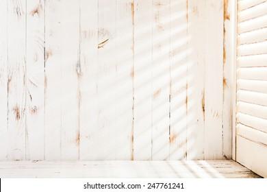 Venetian blinds sunlight on the shabby wooden wall