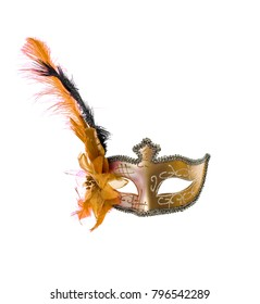 Venetian carnival mask with feathers isolated on a white background.