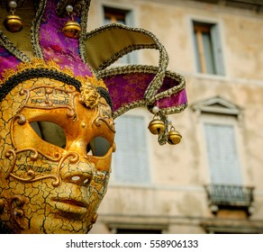Venetian  carnival mask and old palazzo at background. Venice (italy).