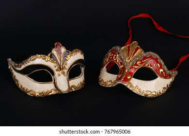Venetian carnival masks on black background