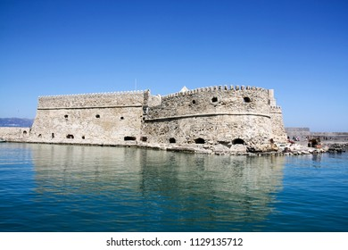 Venetian fort at Heraklion harbor under blue sunny sky in summer time, Crete Island, Greece