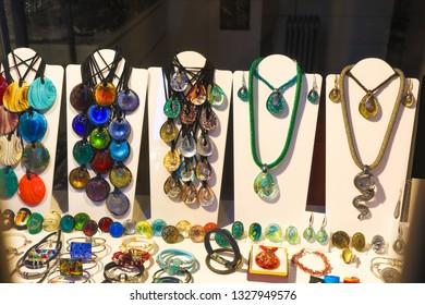 Venetian glass jewelry, multicolor decoration on dark background