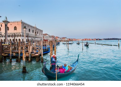 Venetian gondoliers await some tourists to carry around on a gondola in Venice