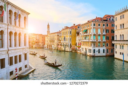 "Venetian gondoliers punting gondolas through ""canal grande"" in Venice, Italy / Next to Rialto Bridge and Palace of the Camerlenghi"