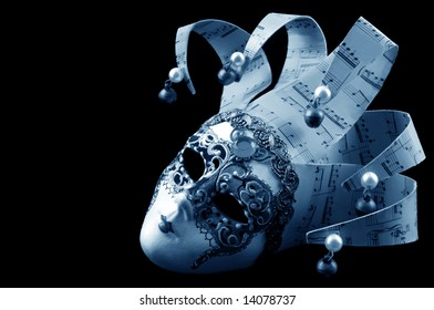 Venetian mask, in blue tone, isolated on black background.