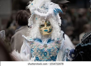 Venetian mask. Day of the Graff of May. Venetian mask. People in festival costume with mask at Venice carnival in Italy. Carnival costumes and masks Venice
