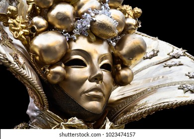 venetian mask with gold leaf, Traditional carnival venetian mask, Beautiful young woman in mysterious colors Venetian mask. Fashion photo. Holidays and celebrations . Party fantasy woman