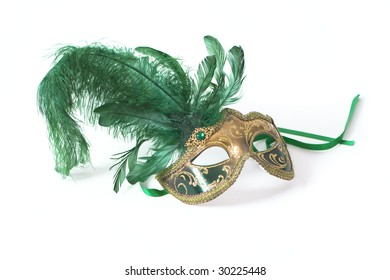 Venetian mask with green feather on white background