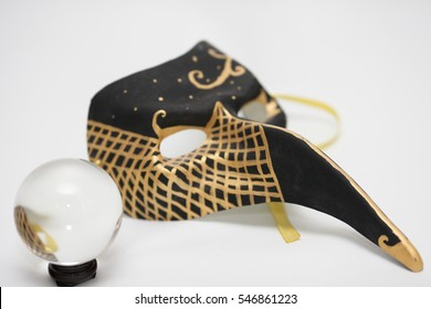 Venetian mask and magic sphere