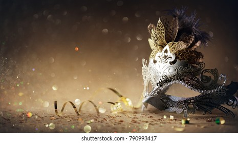 Venetian Mask On Dark Golden Background
