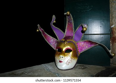 Venetian mask on a windowsill of a hotel room with a copy space. Venice, Italy