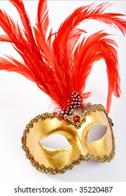 venetian mask with red  plume.