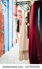 Venetian narrow street and curtains