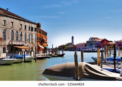 Venetian view with houses and boats in Murano