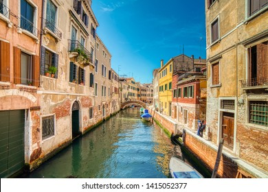VENEZIA, ITALY – MAY 31, 2019: tourists visiting the city and enjoying the view of waters flowing in water channel of Venice
