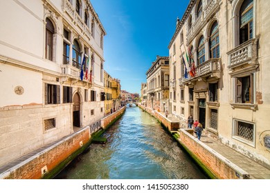 VENEZIA, ITALY – MAY 31, 2019: tourists visiting the city and enjoying the view of waters flowing in water channel of Venice, Fondamenta Sangiantoffetti