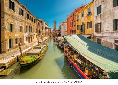 VENEZIA, ITALY – MAY 31, 2019: tourists visiting the city and enjoying fruit for sale on boat near Ponte dei Pugni on water channel of Venice, Fondamenta Alberti