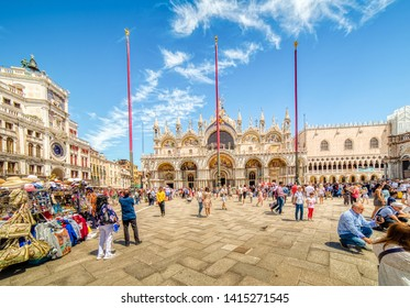 VENEZIA, ITALY - MAY 31, 2019: tourists are enjoying the stunning Basilica and other monuments and buildings of Saint Mark's Square, perhaps the world's most famous squares