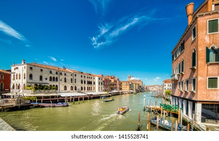 VENEZIA, ITALY – MAY 31, 2019: tourists visiting city while waters flowing in Canal Grande, main channel of Venezia, under Bridge Ponte degli Scalzi