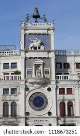 Venezia, VE, Italy - February 5, 2018: Ancient clock tower called Campanile dei Mori di Venezia in Italian language with big bell on top