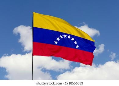 Venezuela flag isolated on the blue sky with clipping path. close up waving flag of Venezuela. flag symbols of Venezuela.