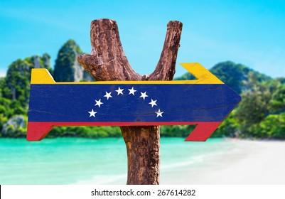 Venezuela Flag wooden sign with beach background