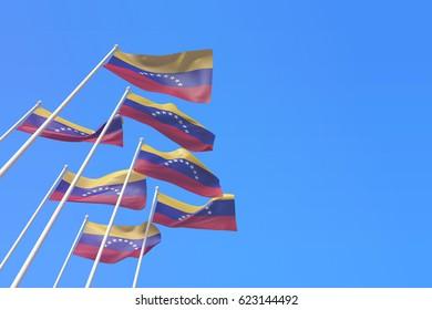 Venezuela flags waving in the wind against a blue sky. 3D Rendering