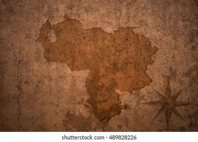 venezuela map on a old vintage crack paper background