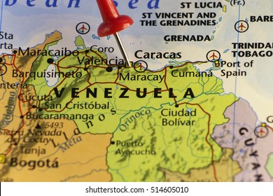 Venezuela map, red pin on Caracas. Copy space available.
