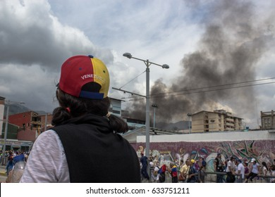 MÉRIDA, VENEZUELA. OCTOBER 2016. Venezuelan people protests against their Government. This protest derived on violent acts.  The smoke at the back comes from a police truck burned by demonstrators.