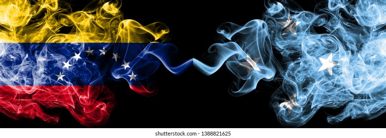 Venezuela vs Micronesia, Micronesian smoky mystic flags placed side by side. Thick colored silky smoke flags of Venezuela and Micronesia, Micronesian.