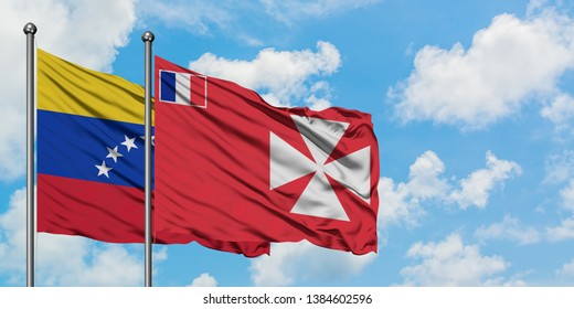 Venezuela and Wallis And Futuna flag waving in the wind against white cloudy blue sky together. Diplomacy concept, international relations.