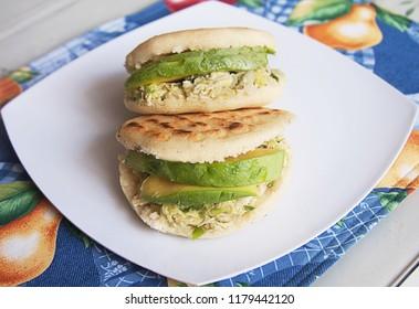 Venezuelan Arepas. Here Homemade Venezuelan Arepas Close up. Reina Pepiada. Avocado and Chicken Arepa.