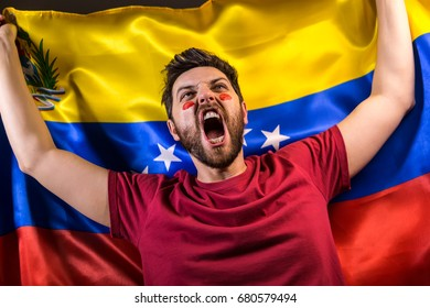 Venezuelan fan holding the national flag