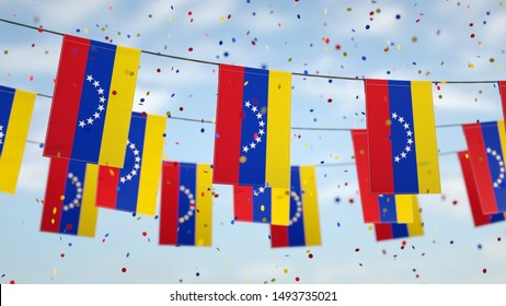 Venezuelan flags in the sky with confetti.