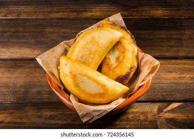 Venezuelan typical food, Empanadas on wood table ready to eat
