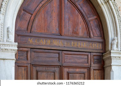 Venice, Academy of Fine Arts wooden portal with golden letters sign in Italy